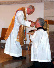 Father Castronovo Giving Communion at St. Anne's
