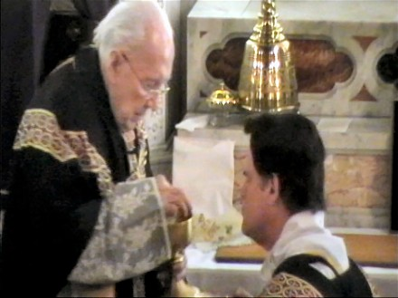 Fr. L'Arche Receiving Communion